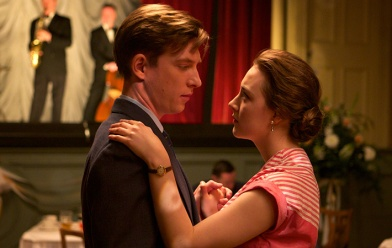 "Domhnall Gleeson as ""Jim"" and Saoirse Ronan as ""Eilis"" in BROOKLYN. Photo by Kerry Brown. © 2015 Twentieth Century Fox Film Corporation All Rights Reserved"